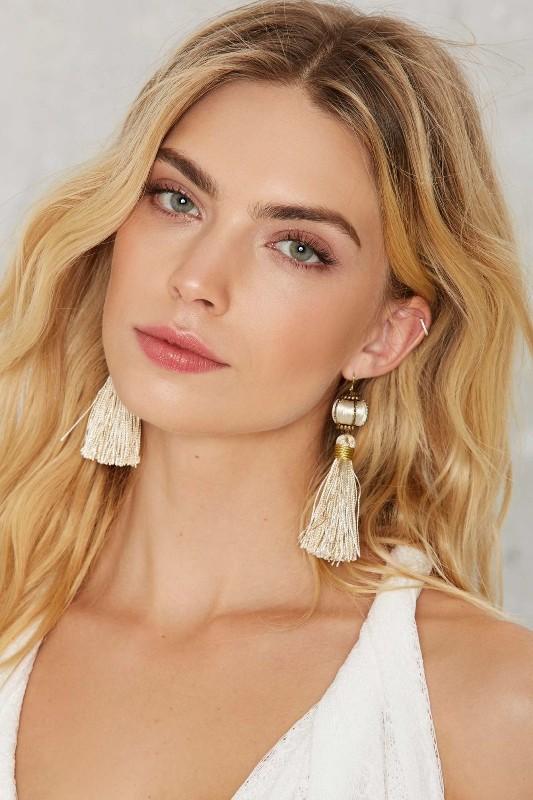 Trendy woman wearing tassel jewelry